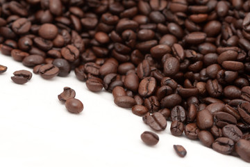 Roasted coffee beans catty-corner isolated