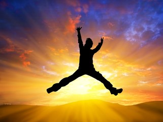 man jumping on a sunset background