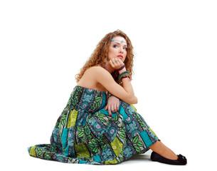 sad hippie girl sitting on the ground