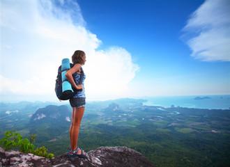 Backpacker on a rock