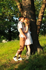 beautiful young couple kiss outdoors in the forest