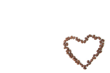 Coffee heart made of beans, white background, lots of copyspace