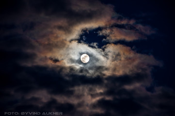 Clouds embracing the moon