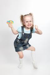 Capricious little girl with lollipop