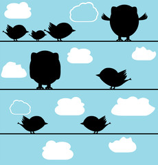 Silhouette of birds owl on a wire with clouds