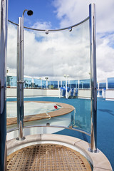 on sundeck of the cruise ship: deck chairs, shower, and pool