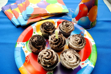 Seven Birthday Cupcakes Over Blue