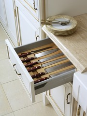 Kitchen box with a set of knifes