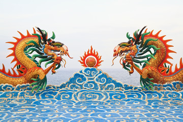 Two chinese dragon statue on the clouds.
