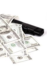 hundred-dollar bills on the gun
