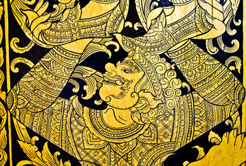 Gold monkey on thai temple door