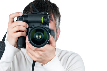 Young man with camera, isolated on white background, focus is on