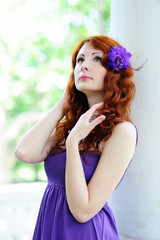 Young woman portrait with flower in her hair.