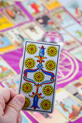 Tarot card held in the hand (1).