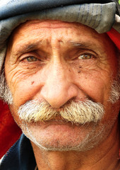 Old oriental man in style with an amazing expression