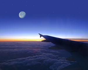 evening sky with wing of plane