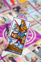 Cavalier D'Epee, Tarot card held in the hand