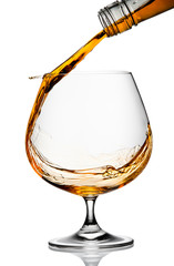 Wall Mural - The glass with splashes brandy