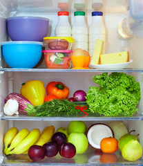 refrigerator full of healthy fruits, vegetables and dairy