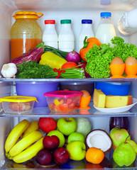 refrigerator full of healthy food. fruits, vegetables