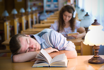 Sweet Dreams in a Library: Portrait of sleeping student
