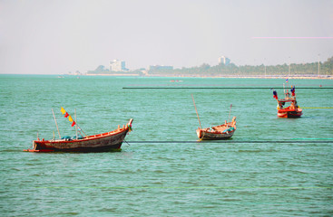 Three boat on sea blackground