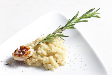 grilled Saint Jacques mollusc on rosemary needle with risotto