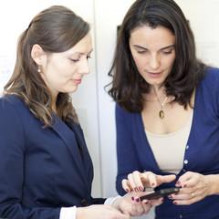 Woman choosing a phone