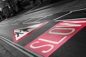 Foto op Canvas Rood, zwart, wit Road sign, slow