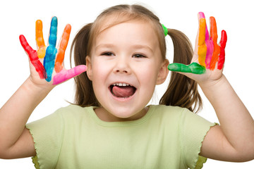 Cheerful girl with painted hands