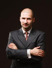 Portrait of a successful businessman on black