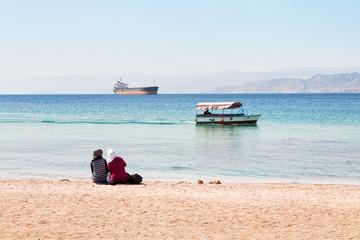 people on urban beach in Aqaba town