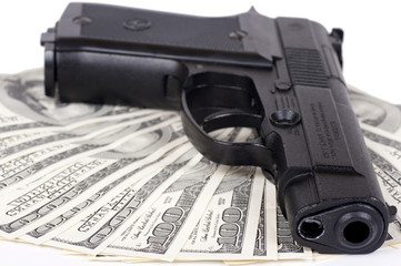 hundred-dollar bills on the gun isolated on white background