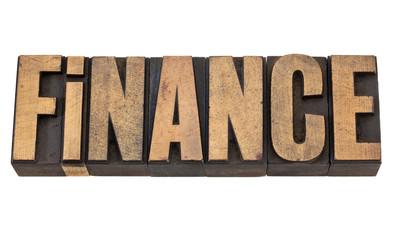 finance word in wood type