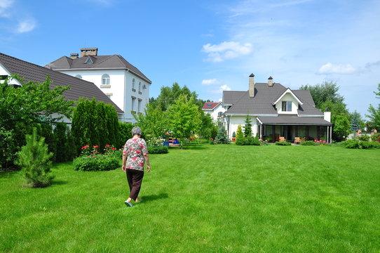 senior woman on garden of her house