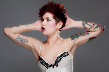 Cute young female with tattoos