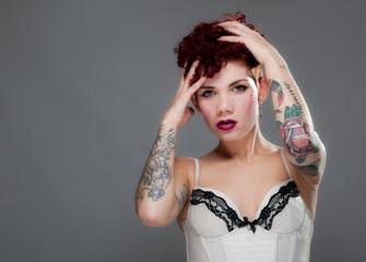 Beautiful young tattooed female