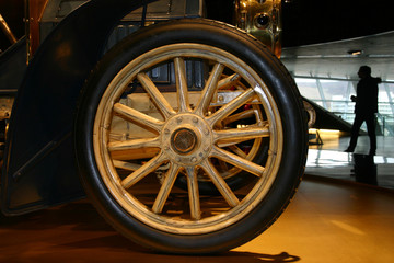 Wheel from the ancient car and the person