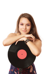 A young girl with a vinyl record