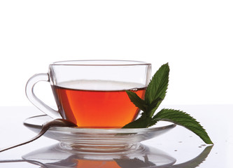 A cup of tea and mint leaves