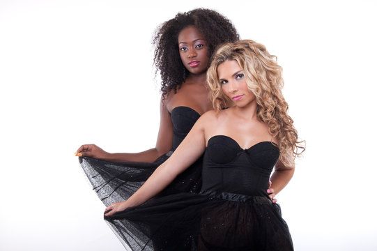 two female models in a black transparent dress