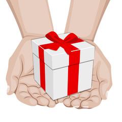 Manos ofreciendo un pequeño regalo
