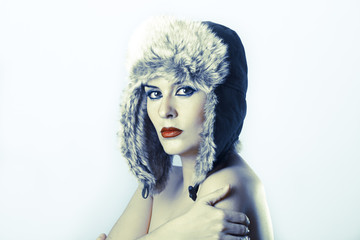 Sexy young with Russian hat on white background