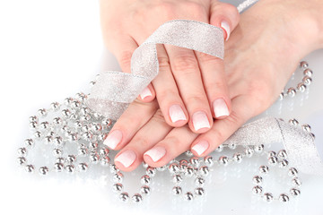hands with beautiful winter design, ribbon and beads isolated