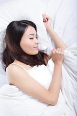 Woman sleeping on the bed in the morning