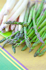 green and white asparagus on a table