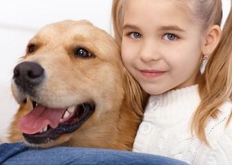 Portrait of lovely little girl and dog