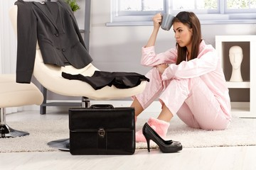 Tired woman getting ready for business