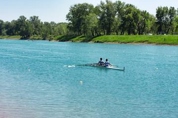 Two young men rowing on lake Jarun, Croatia