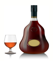 Snifter glass of cognac and bottle